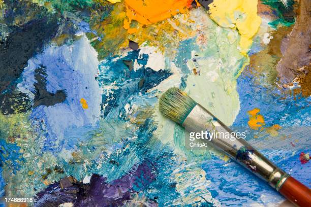 Artists acrylic paint palette close up semi abstract background