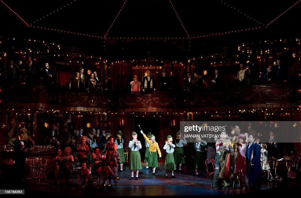 Artists and dancers perform during a full dress rehearsal for Gale Edward's production 'La Boheme' at the Sydney Opera House on December 29, 2012. Australian Opera director Gale Edward's adaptation of Puccini's La Behome which opens in Sydney on New Years eve, centers on a group of bohemian friends - a poet, a philosopher, a musician and a painter.