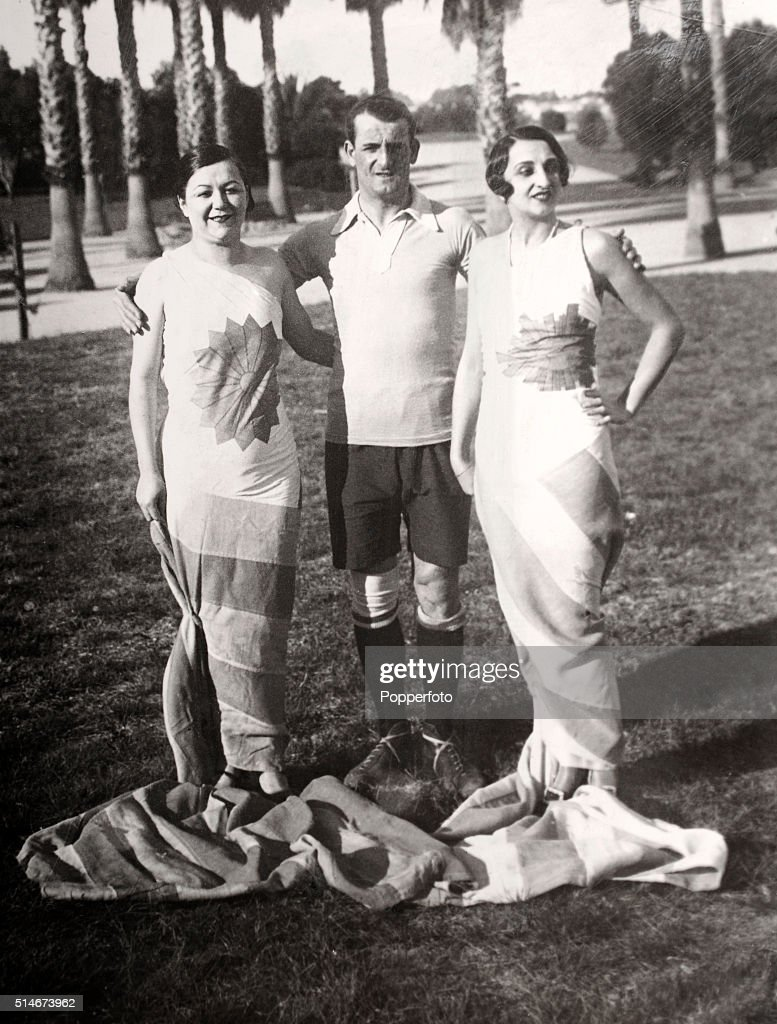 Artists and fashion designers Iris Marga (left) and Maria Ester Duckse with Jose Nasazzi, captain of the Uruguay football team, which won the first football World Cup, circa July 1930.