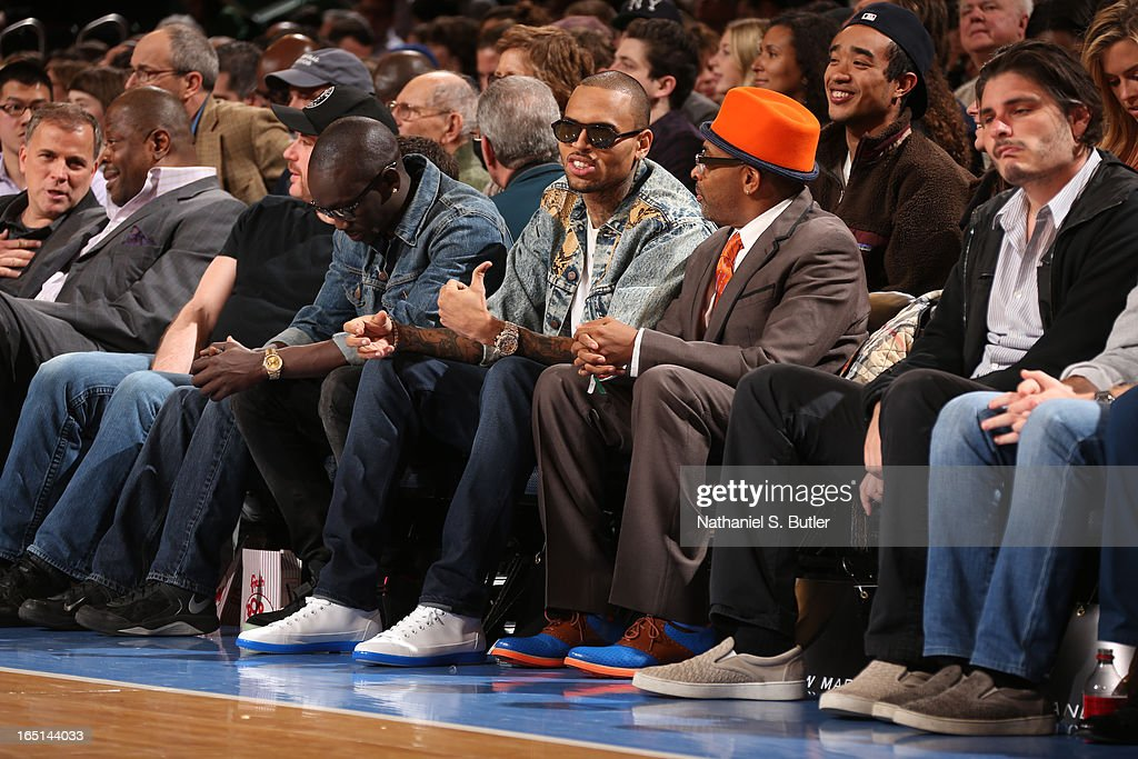 Artists Chris Brown and Director Spike Lee attend a game between the New York Knicks and the Boston Celtics on March 31, 2013 at Madison Square Garden in New York City.