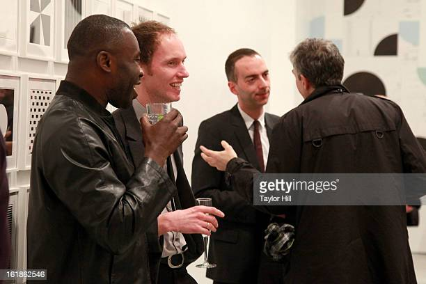 Artists Chris Ofili and Michael Riedel attend the Michael Riedel Art Exhibition Powerpoint at David Zwirner Gallery on February 16 2013 in New York...
