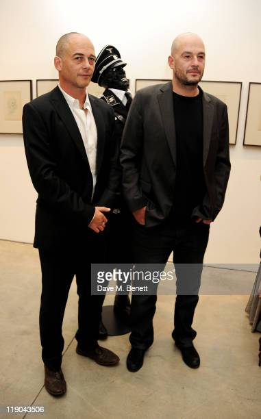 Artists Dinos Chapman and Jake Chapman attend a private viewing of their new exhibit 'Jake or Dinos Chapman' at White Cube Gallery on July 14 2011 in...