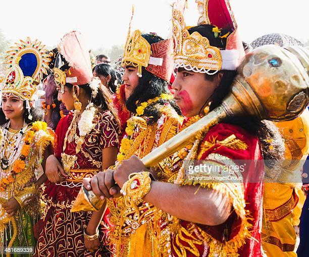 Artists dressed as Hindu mythological characters during a procession Pushkar Camel Fair Pushkar Ajmer Rajasthan India