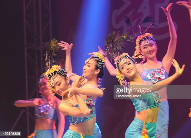 Artists from China perform during an event to celebrate Christmas and New Year on December 23 2013 in Kolkata India