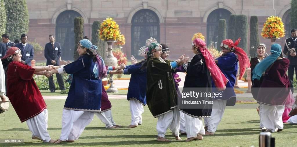 Artists from Jammu and Kashmir, who participated in the Republic Day Parade-2013, performs during a meeting with President Pranab Mukherjee at Rashtrapati Bhavan on January 27, 2013 in New Delhi, India.