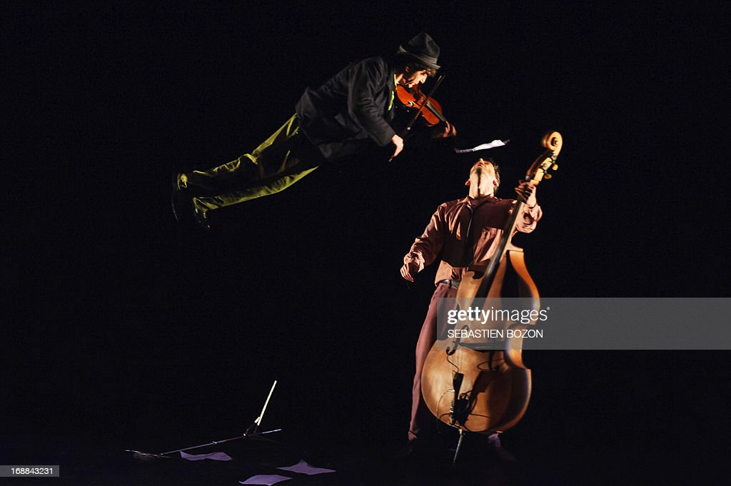 Artists from 'Le cirque Plume' company perform during the rehearsal of 'Tempus Fugit ?' show on May 15, 2013 in Besançon, eastern France.