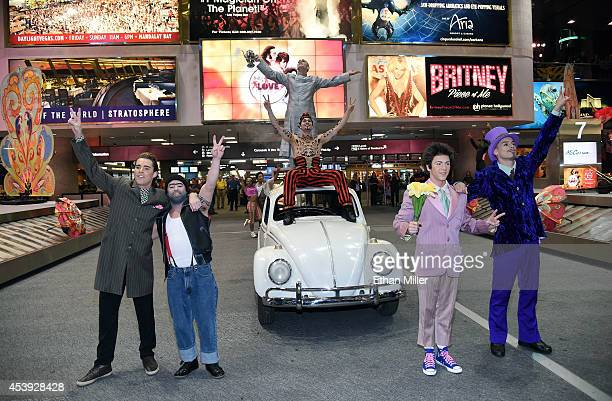 Artists from 'The Beatles LOVE by Cirque du Soleil' perform in the baggage carousel area at McCarran International Airport in celebration of the 50th...