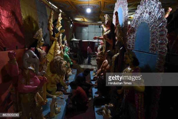 Artists from West Bengal making idols for Durga puja at Shiv Mandir Vashi on September 22 2017 in Mumbai India Durga Puja also called Durgotsava and...