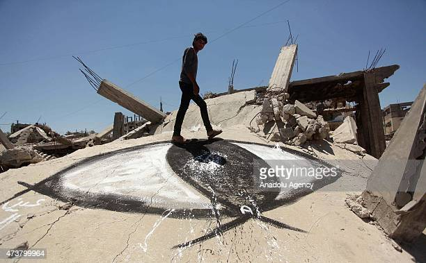 Artists in the Gaza Strip commemorate the 67th anniversary of Nakba also known as Day of the Catastrophe by painting graffitis on the walls of...