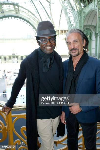 Artists K Terence Johnson Alter and Alberto Bertti attend the 'Revelations' Fair at Balcon d'Honneur du Grand Palais on May 5 2017 in Paris France