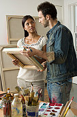 Artists Looking at Canvas in Studio
