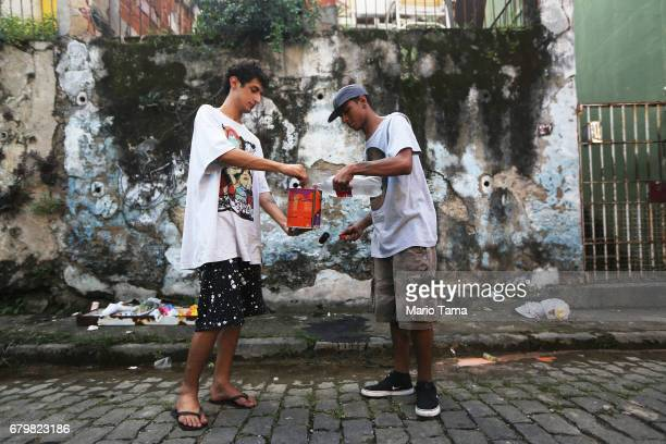 Artists Lucas Squiovane and Pedro Semnome prepare to paint graffiti in the Providencia ÔfavelaÕ community the oldest favela in Rio as part of the...