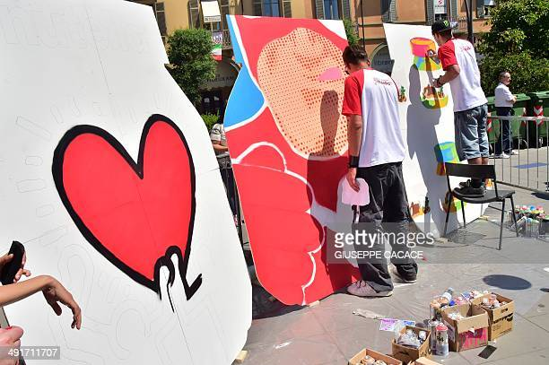 Artists make paintings on canvas shaped as Nutella's jar on May 17 2014 in Alba northern Italy during the celebrations of the 50th anniversary of...