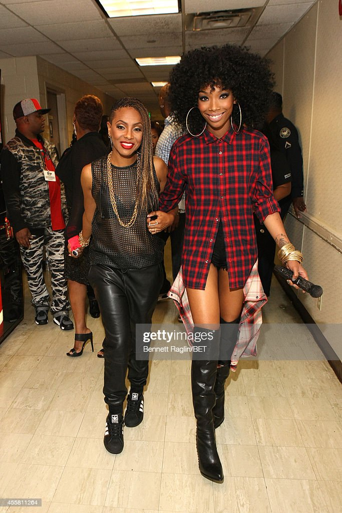 Artists MC Lyte (L) and Brandy pose backstage at the BET Hip Hop Awards 2014 at Boisfeuillet Jones Atlanta Civic Center on September 20, 2014 in Atlanta, Georgia.