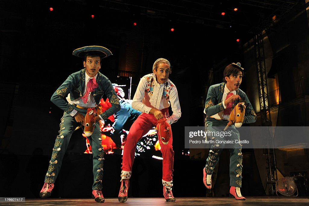 Artists of Cabaret Capicho group perform during the presentation of the show 'El folk chou' During the 6th International Festival Siguientescena at Plaza de Armas on August 16, 2013 in Queretaro, Mexico.