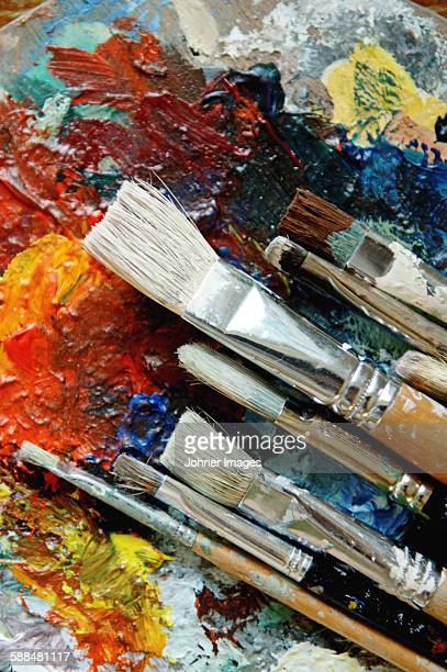 Artists oil painting palette with brushes