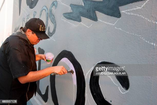 Artists paint a mural in memory of Mexican journalist Javier Valdez in Monterrey Mexico on May 19 2017 'The other festival' project aims to raise...