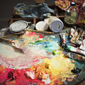 Artist's palette, paints and tools, close-up