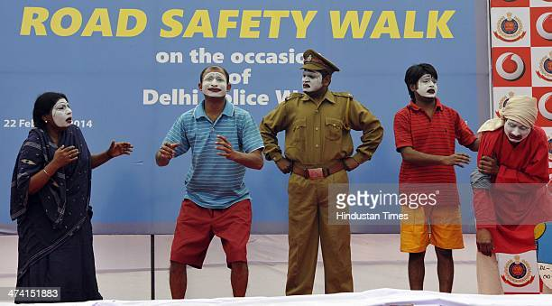 NGO artists perform a street play in Road safety march organised by Delhi Traffic police on road safety during the Road Safety week at Raj Path on...