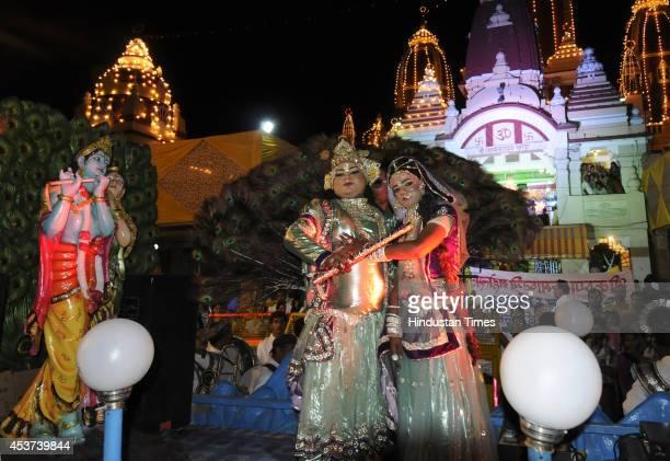 Artists perform as Radha and Krishna during Krishna Janmashtami festival celebrations at Birla Mandir on August 17 2014 in New Delhi India Hindu...