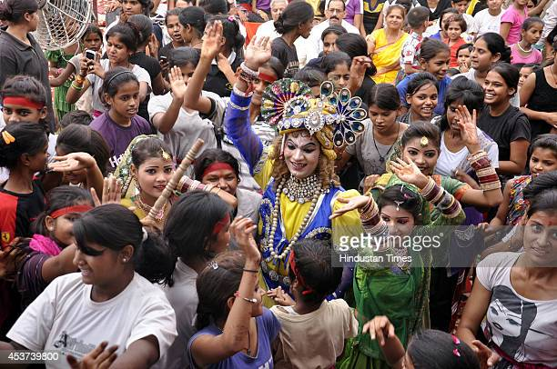 Artists perform as Radha and Krishna during Krishna Janmashtami festival celebrations on August 17 2014 in Ghaziabad India Hindu devotees celebrate...