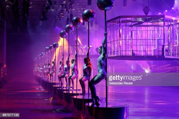 Artists perform at the Plein Sport show during Milan Men's Fashion Week Spring/Summer 2018 on June 18 2017 in Milan Italy