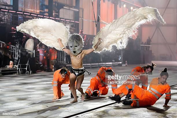 Artists perform during a show on the opening day of the Gotthard rail tunnel at the fairground Rynaecht at the northern portal in Erstfeld...