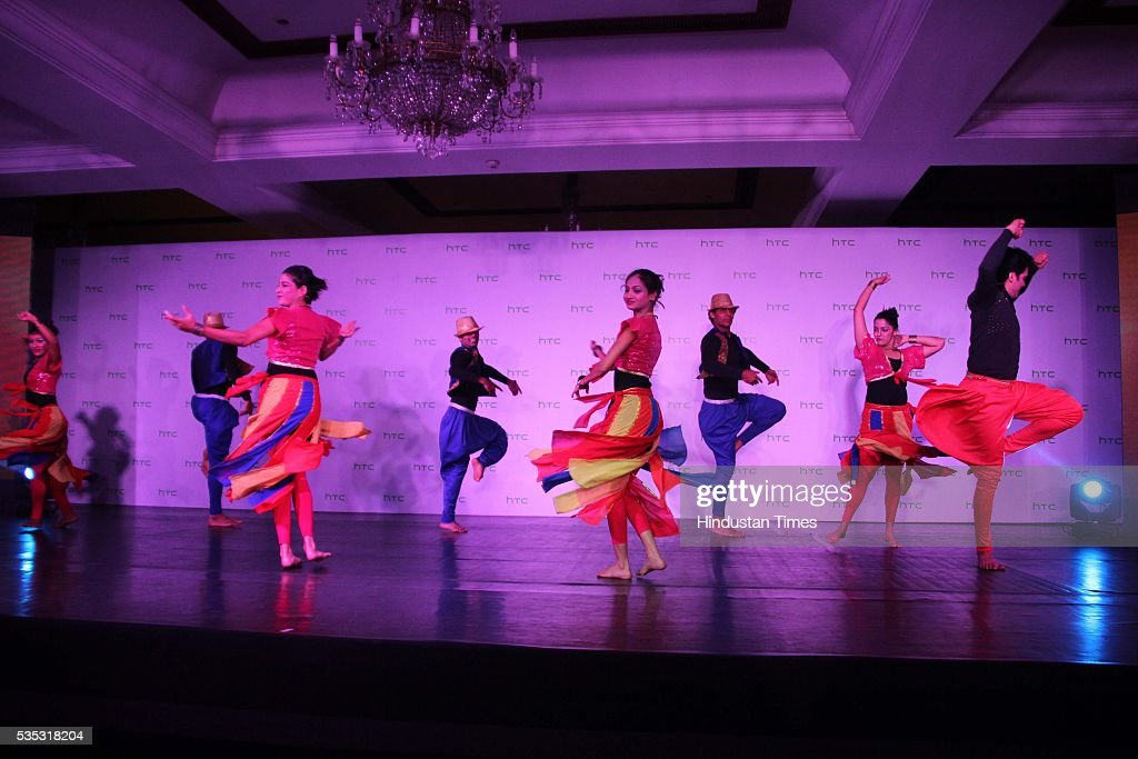 Artists perform during the launch of global flagship smartphone, HTC 10 at Taj Mahal Hotel, on May 26, 2016 in New Delhi, India. Faisal Siddiqui, President, HTC South Asia, said, 'India is one of the fastest growing Smartphone markets globally and the customers are technology savvy. We are pleased to launch our all-new range of smartphones in the HTC One and Desire categories. Our new range focuses on providing distinctive features with an outstanding user experience along with the freedom to personalise their smartphones. Each smartphone has a unique customer value proposition and is targeted at a specific audience. We strongly believe our flagship HTC 10, the HTC One X9, and our youthful Desire smartphones will capture the mindshare of our consumers.'