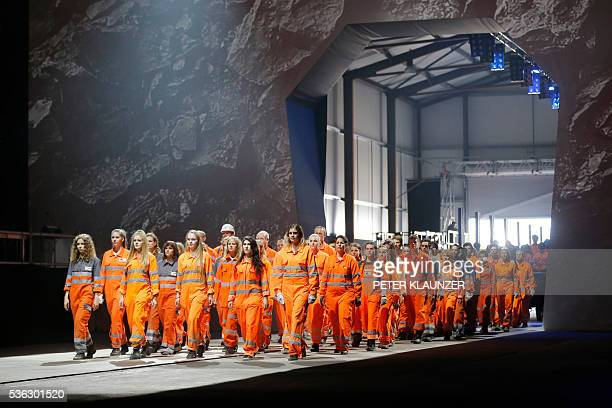 Artists perform during the opening show directed by German director Volker Hesse on the opening day of the Gotthard rail tunnel the longest rail...