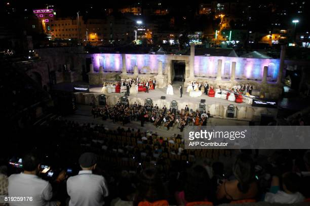 Artists perform Giuseppe Verdi's La Traviata directed by Luigi Orfeo and conducted by Lorenzo Tazzieri during the Amman Opera Festival at the Roman...