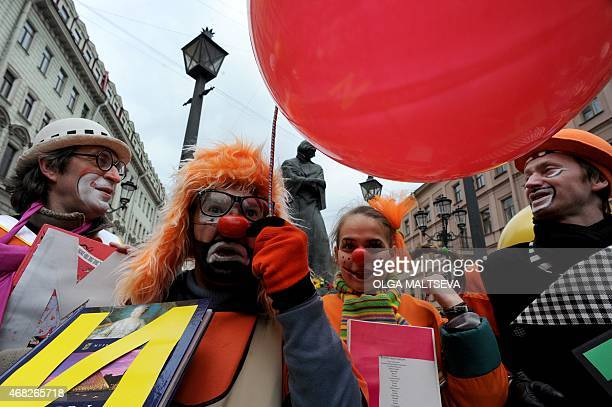 Artists perform in central Saint Petersburg on April 1 2015 to mark April Fools' Day AFP PHOTO / OLGA MALTSEVA
