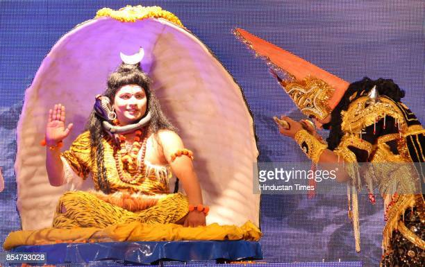 Artists perform the traditional 'Ramlila' drama narrating the life of Hindu God Rama on stage during the celebration to mark 'Dussehra' Festival...