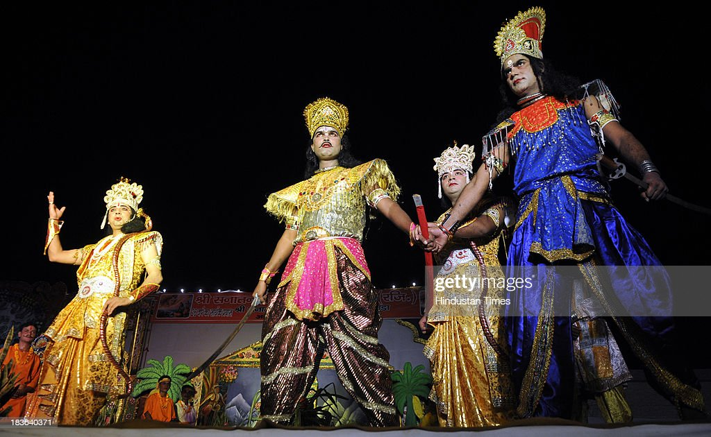Artists performing at Ramlila organized at Sector 33 on October 8, 2013 in Noida, India. Ramlila is a dramatic folk re-enactment of the life of Hindu Lord Rama's victory after a ten day battle with the ten headed Demon King Ravana.