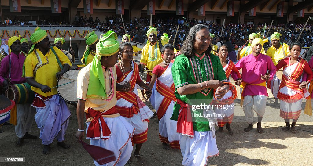 Artists performing tribal folk dance during the swearing in ceremony of Jharkhand Chief Minister Raghuvar Das at Birsa Munda Football stadium on...