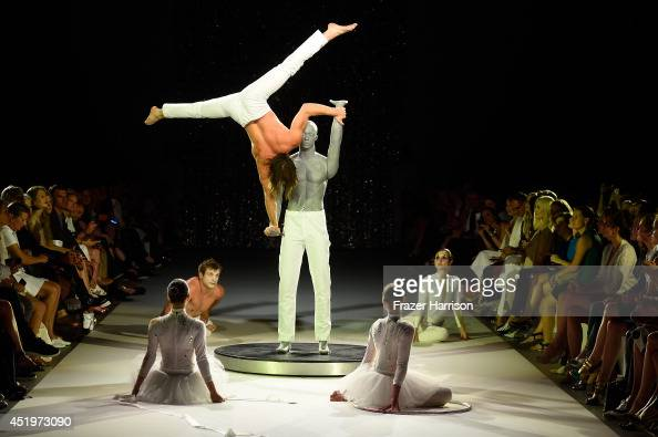 Artists performs on the runway as part of the Marc Cain show during the MercedesBenz Fashion Week Spring/Summer 2015 at Erika Hess Eisstadion on July...