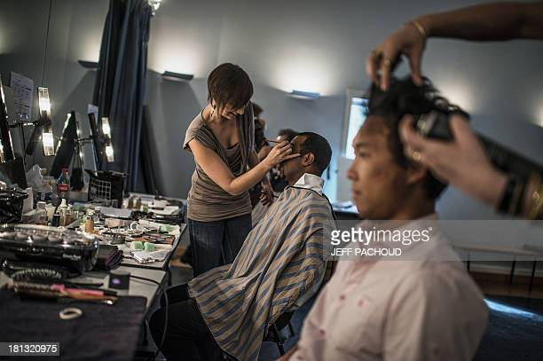 Artists prepare for the dress rehearsal of Wagner's opera 'The Ring' in Dijon's Auditorium on September 9 2013 AFP PHOTO / JEFF PACHOUD