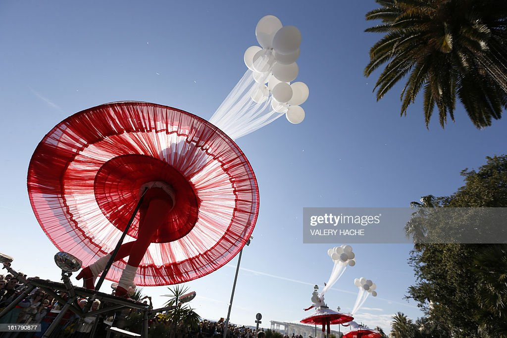 Artists take part in the Nice Carnival parade on February 16, 2013 in Nice, southeastern France. The Carnival, starting from February 15 until March 6, 2013, will celebrate the 'King of the five continents', marking the 140th anniversary of the French Riviera Nice carnival.