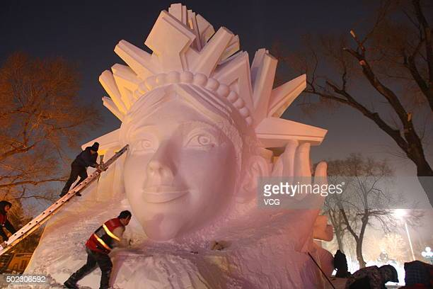 Artists work on a snow sculpture at the 17th Harbin Ice And Snow World during its test run on December 22 2015 in Harbin China The event will run...