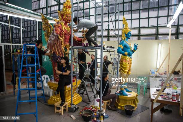 Artists work on decorative items for the cremation ceremony of King Bhumibol Adulyadej in a studio at the Fine Arts Department in Bangkok Thailand on...