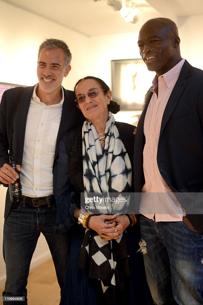 Artists Yariv Milchan, <a gi-track='captionPersonalityLinkClicked' href=/galleries/search?phrase=Mary+Ellen+Mark&family=editorial&specificpeople=5617373 ng-click='$event.stopPropagation()'>Mary Ellen Mark</a>, and Musician Seal attend G-Star RAW unveils RAW Leica at the Leica store opening on June 20, 2013 in West Hollywood, California.