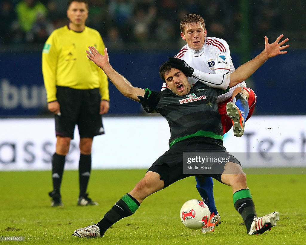 Artjom Rudvevs (L) of Hamburg and Sokratis (R) of Bremen battle for the ball during the Bundesliga match between Hamburger SV and SV Werder Bremen at Imtech Arena on January 27, 2013 in Hamburg, Germany.