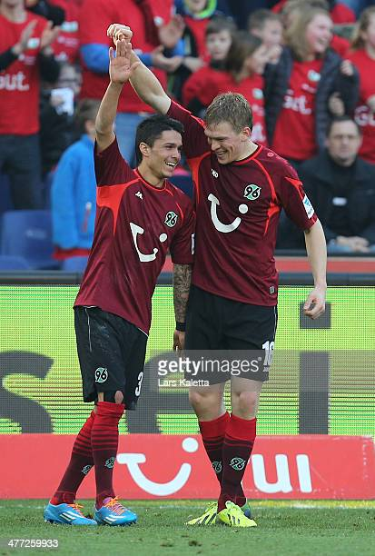 Artjomas Rudnevs of Hanover celebrates his goal with Leonardo Bittencourt during the Bundesliga match between Hannover 96 and Bayer Leverkusen at...