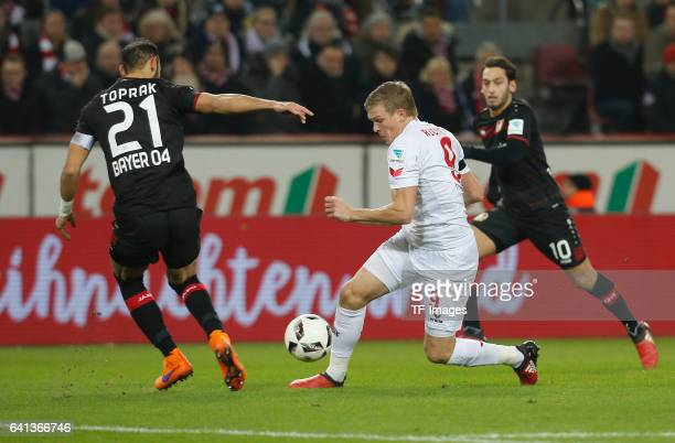 Artjoms Rudnevs of Cologne and Oemer Toprak of Leverkusen and Hakan Calhanoglu battle for the ball during the Bundesliga soccer match between 1 FC...
