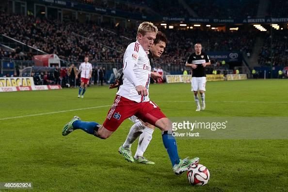 Artjoms Rudnevs of Hamburg and Gotoku Sakai of Stuttgart compete during the First Bundesliga match between Hamburger SV and VfB Stuttgart at Imtech...