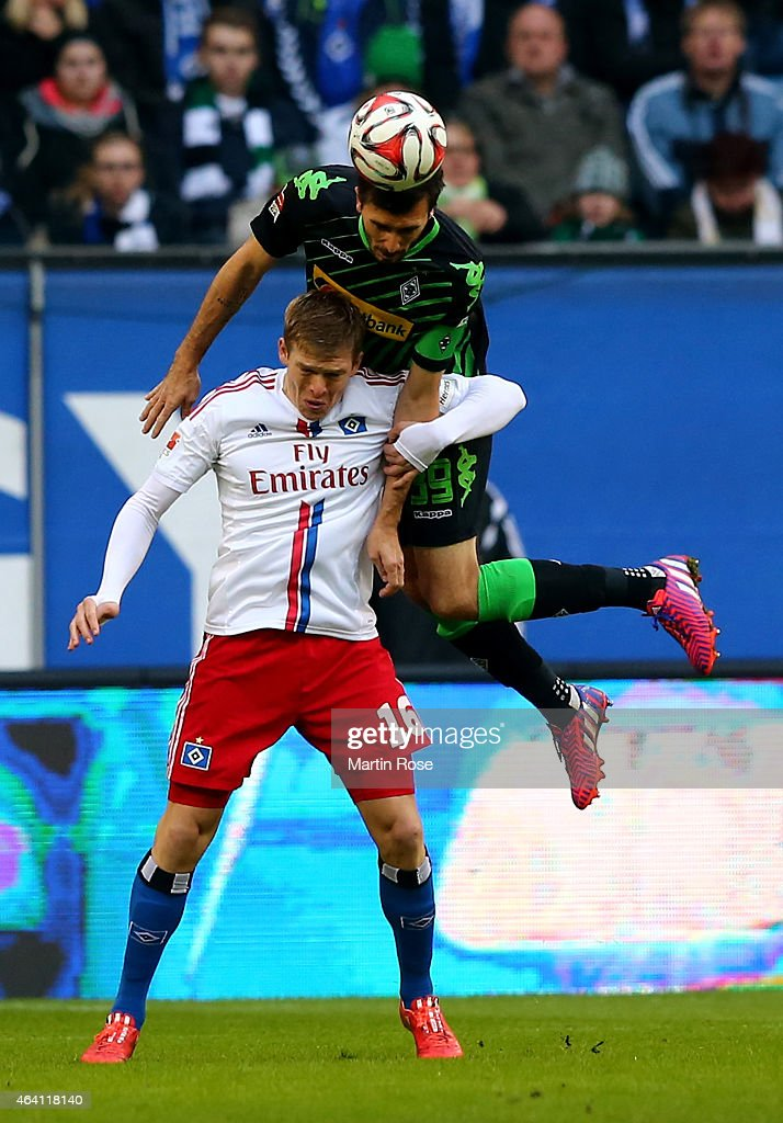Artjoms Rudnevs of Hamburg and Martin Stranzl of Gladbach battle for the ball during the Bundesliga match between Hamburger SV and Borussia...