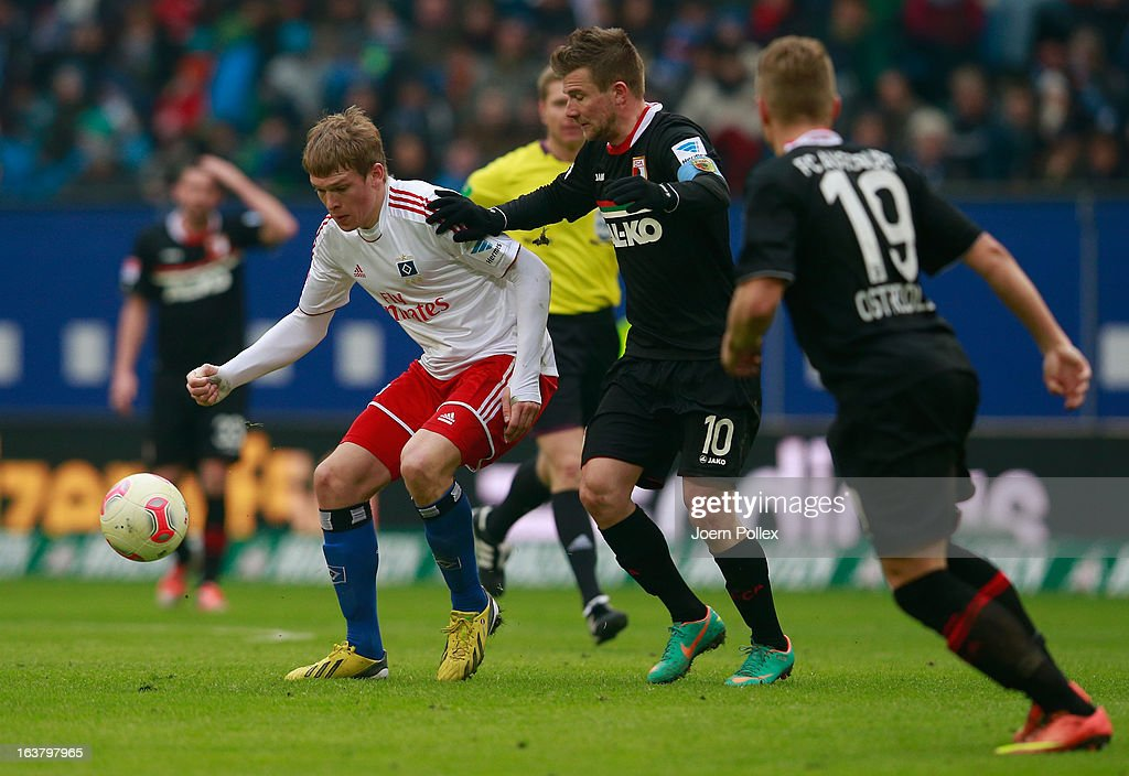 Artjoms Rudnevs (L) of Hamburg and Tobias Werner of Augsburg compete for the ball during the Bundesliga match between Hamburger SV and FC Augsburg at Imtech Arena on March 16, 2013 in Hamburg, Germany.