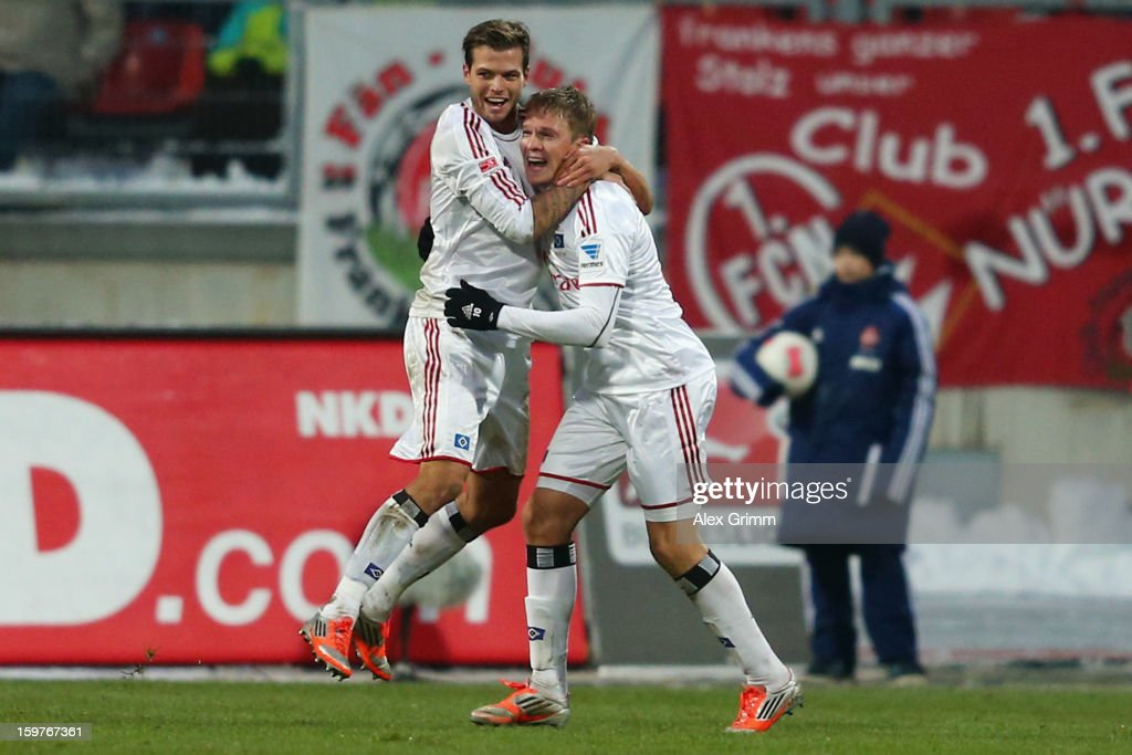 Artjoms Rudnevs (R) of Hamburg celebrates his team's first goal with team mate <a gi-track='captionPersonalityLinkClicked' href=/galleries/search?phrase=Dennis+Diekmeier&family=editorial&specificpeople=4191359 ng-click='$event.stopPropagation()'>Dennis Diekmeier</a> during the Bundesliga match between 1. FC Nuernberg and Hamburger SV at Easy Credit Stadium on January 20, 2013 in Nuremberg, Germany.