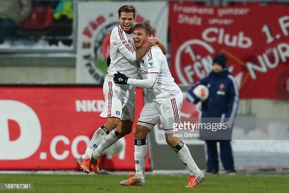 Artjoms Rudnevs of Hamburg celebrates his team's first goal with team mate Dennis Diekmeier during the Bundesliga match between 1 FC Nuernberg and...