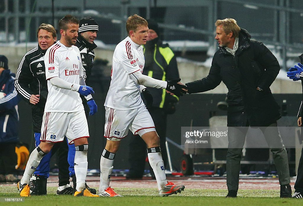 Artjoms Rudnevs (C) of Hamburg celebrates his team's first goal with team mate Rafael van der Vaart and head coach <a gi-track='captionPersonalityLinkClicked' href=/galleries/search?phrase=Thorsten+Fink&family=editorial&specificpeople=2381735 ng-click='$event.stopPropagation()'>Thorsten Fink</a> during the Bundesliga match between 1. FC Nuernberg and Hamburger SV at Easy Credit Stadium on January 20, 2013 in Nuremberg, Germany.