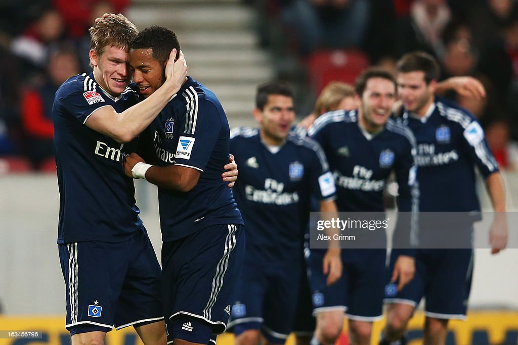 Artjoms Rudnevs (L) of Hamburg celebrates his team's third goal with team mate <a gi-track='captionPersonalityLinkClicked' href=/galleries/search?phrase=Dennis+Aogo&family=editorial&specificpeople=787086 ng-click='$event.stopPropagation()'>Dennis Aogo</a> and others during the Bundesliga match between VfB Stuttgart and Hamburger SV at Mercedes-Benz Arena on March 10, 2013 in Stuttgart, Germany.